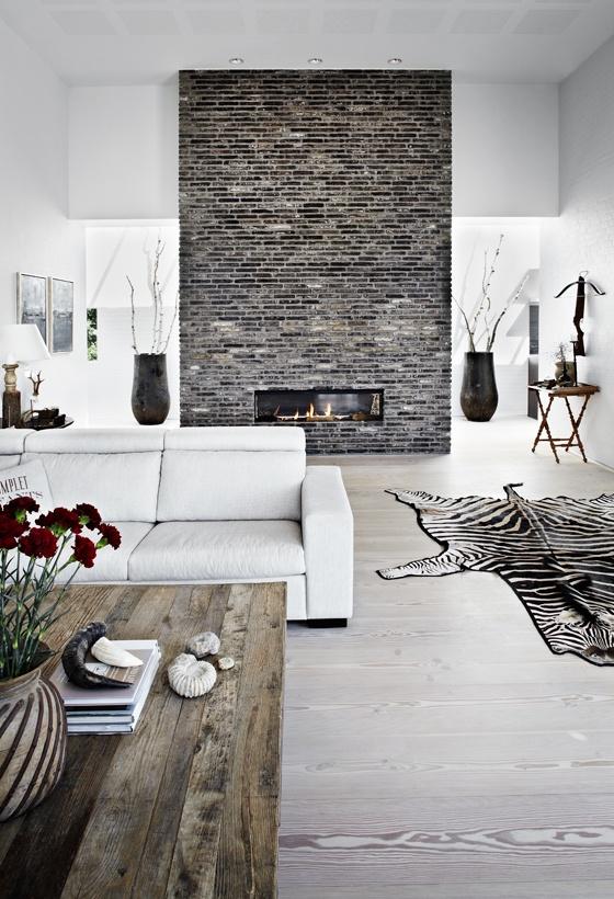 Wn trze dnia salon z szar ceg adne rzeczy for Grey brick wallpaper living room